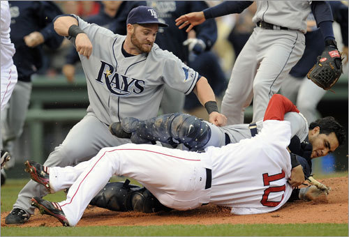 In what is possibly Crisp's most remembered moment in a Boston uniform, the Red Sox center fielder charged the mound in this June 5 altercation with the Rays at Fenway . Here, Rays DH Jonny Games cocks his arm as Rays catcher Dioner Navarro holds Crisp on the ground and in a headlock.
