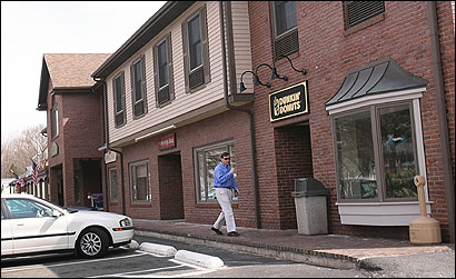 Wellesley officials fear that the new Dunkin' Donuts shop will damage the character of the town center.