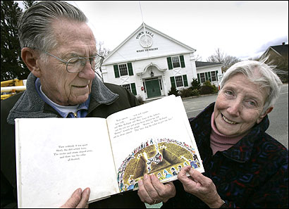 Dick and Sue Berkenbush hold 'Mike Mulligan and His Steam Shovel' at West Newbury Town Hall, which is featured in the story. 'Katy and the Big Snow' is based on Gloucester Highway Department's snow plow.