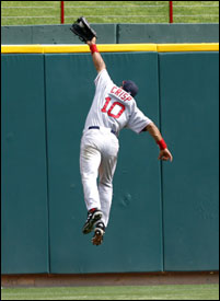 Newcomer Coco Crisp is Johnny on the spot as he makes a leaping grab to rob Laynce Nix of an extra-base hit in the ninth.