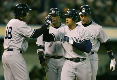 Alex Rodriguez is welcomed home by Johnny Damon (left) after his grand slam.