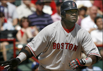 David Ortiz wasn't distracted by contract negotiations on Opening Day. The Sox slugger collected three hits, including a home run off of Rangers ace Kevin Millwood.