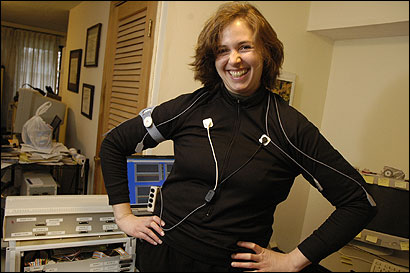 Keith Lockhart, five Boston Symphony Orchestra musicians, and about 50 audience members will be wired with sensors during a concert on April 4, as part of a novel scientific experiment. Above, Teresa Marrin Nakra, one of the scientists, modeled the 'Conductor's Jacket' she invented.