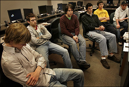 Emerson sophomore Kevin Clay (left), and classmates in the Images of News class as their assistant professor pondered after an instructor asked them to think about the people who were working to make the campus a better place before the fatal accident.