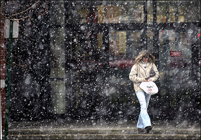 Debbie Lundgren of Hanson emerged from a store April 5 to find a snow squall.