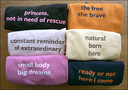 Newburyport resident Jenifer Hoffman launched a business after noticing most messages on clothing for adults and children are negative, violent, or contain sexual innuendos. Above, some of her positive T-shirts.