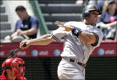 Jorge Posada uncorks his second homer of the game, a leadoff blast in the fifth. He drove in five of the Yankees' 10 runs.