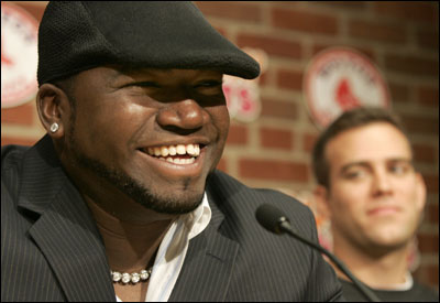 David Ortiz was all smiles after the announcement that he had signed a four-year contract extension with the Red Sox.