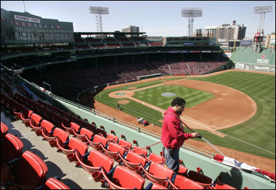 Worker Franklin Pimentel hoses down the Pavilion seats at Fenway Park the day before the home opener.