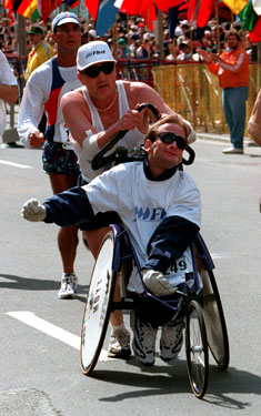 Crowds cheered for Team Hoyt as they approached the finish line at the 1997 Boston Marathon.