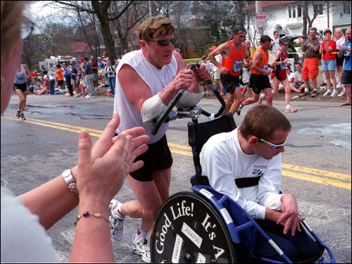 The father-son duo was back pounding the pavement in 2004, once again battling Heartbreak Hill on the way to completing their 23rd Boston Marathon.