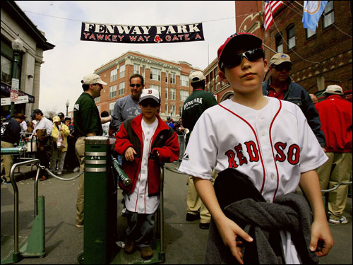 Michael Shea, 11, of Arlington, walked through the turnstile to watch the Red Sox take on the Toronto Blue Jays in the Fenway Park 2006 opener on Tuesday.