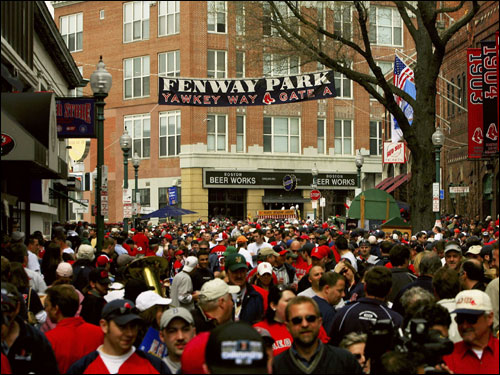 Fans walked along Yawkey Way outside of Fenway Park before the home opener.