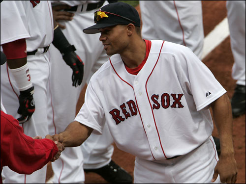 Coco Crisp shook hands with manager Terry Francona during pregame introductions.