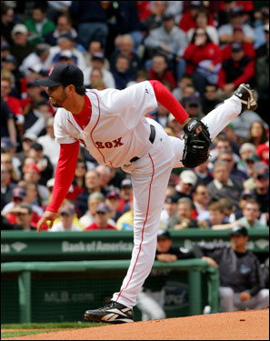 Josh Beckett walked three batters in the first inning but allowed just one run.