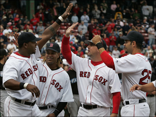 Wily Mo Pena, left, high-fived teammates Manny Ramirez, Trot Nixon, and Mike Lowell during home Opening Day ceremonies.