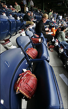 Baseball gloves greeted fans who were seated in the new EMC Club at Fenway Park.