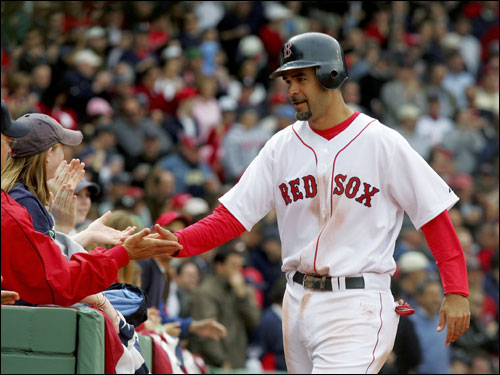 Mike Lowell was congratulated by fans after collecting his fourth hit of the day.