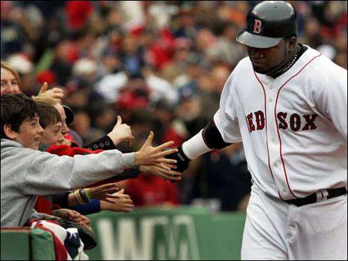 David Ortiz high-fived some Red Sox fans after hitting a solo home run in the seventh inning.