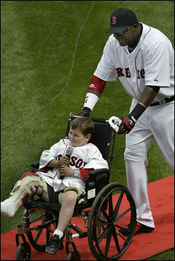 David Ortiz pushed Leandre in a wheelchair before the game.