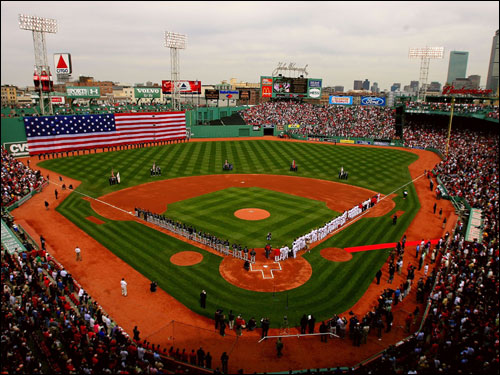 A giant flag hung from the Green Monster during player introductions.