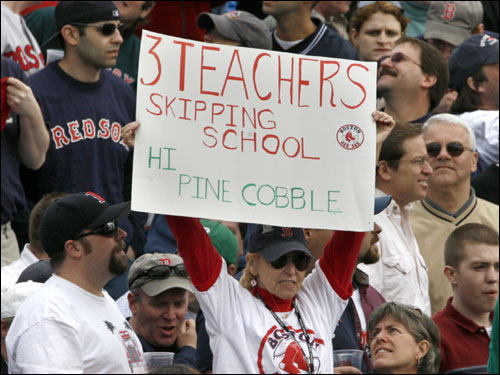 Some Red Sox fans held a sign admitting to skipping school for the home opener.