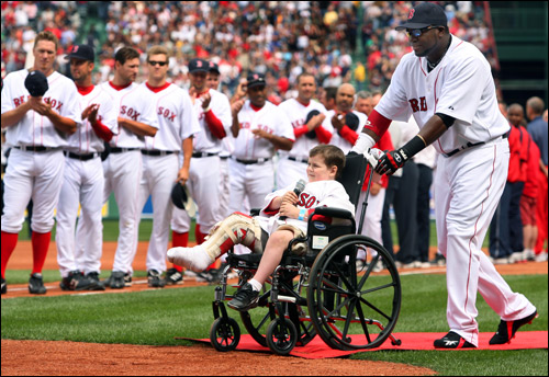 Ortiz escorted Leandre out to sing the national anthem.