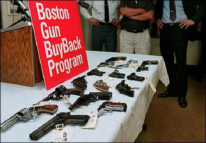 Mattapan police displayed guns in 1996 at their station that were turned in to authorities.