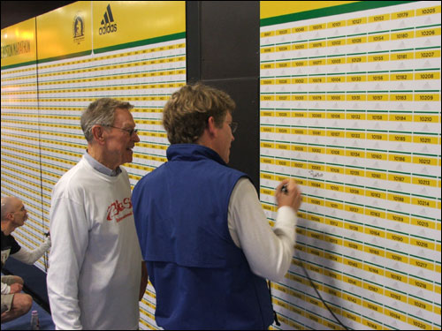 Father and son Vince (right) and Myron Hunt signed a wall with a space for each of the more than 22,000 bib numbers in the race. The question posed by Adidas, the sponsor of the wall, is 'What are you running for?' The younger Hunt has run 30 marathons, but this is the first Boston Marathon for his father, 75, who grew up in Lynn and is celebrating his birthday. In response to the question on the wall, Vince Hunt wrote, 'To be with my dad.'