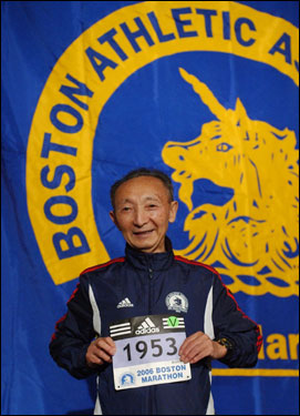 Keizo Yamada, 78, of Japan, held up his bib number during a breakfast in preparation for the running of the 110th Boston Marathon on Monday. Yamada, who commemorated the 52nd anniversary of his victory in 1953 by competing in 2005, will be running again this year.