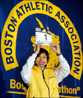Reiko Tosa of Japan held up her number one Boston Marathon bib during the pre-race breakfast.