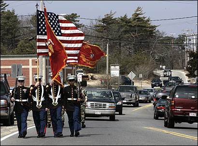 A Marine honor guard marched down State Road in Plymouth yesterday. The town honored Marine Corps Lance Corporal Jeffrey C. Burgess, who was killed in Iraq two years ago.