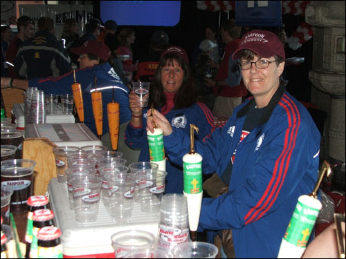 Kathy Walsh (left) and Sue Johnson served libations to some thirsty runners courtesy of the Harpoon Brewery.