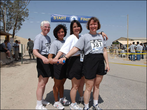 "From left: Lt. Col. Ethel Roberson, 57, Lt. Col. Doreen Aqin, 39, Capt. Vivianna Mestas, 45, and Lt. Col. Judith Graham, 44, run the Boston Marathon in Iraq as a relay team. The self-titled ""Nightingale Meanders"" are all nurses with the 10th Combat Support Hospital from Ft. Carson, Colo., and ran the marathon in 5:13:44."