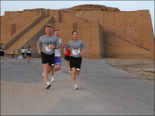 Capt. Christian Jenni (left) and Sgt. Traci Varrasso, both members of the 207th Mobile Public Affairs Detachment, pass the Ziggurat of Urr. The 50-foot tall relic dates to some 4,000 years old and is currently protected by Coalition forces.
