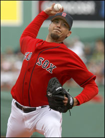 Josh Beckett, 3-0 to start his debut season with the Red Sox, is second in the AL with a 1.29 ERA.