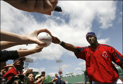 Wily Mo Peña signed autographs before Sunday's game. The fans weren't as welcoming when they booed the Red Sox right fielder after two botched plays in the field.