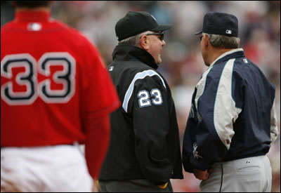 With Jason Varitek (left) securely on first base, Mariners manager Mike Hargrove argues with umpire Rick Reed, who ruled Richie Sexson failed to tag Varitek, allowing a run to score.