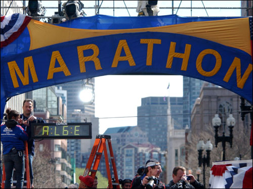 A marathon worker set up the time clock at the finish line of the Boston Marathon in Copley Square.