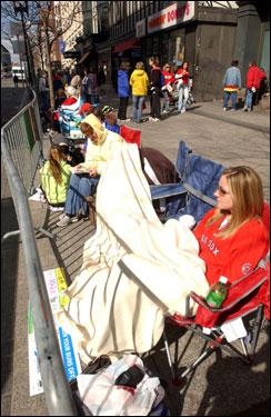 Danielle Aldrich, of Iowa, waited along the finish area near Copley Square.