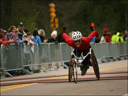 An unidentified wheelchair athlete made his way along the course from Hopkinton.