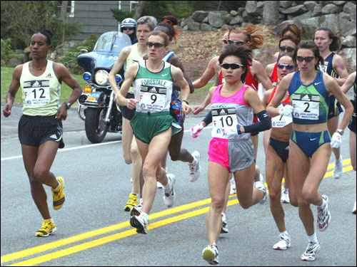 Elite runners (left to right) Kutre Dulech of Ethiopia (12); Bruna Genovese of Italy (9); Kiyoko Shimahara of Japan (10); and Jelena Prokopcuka of Latvia formed a lead pack.