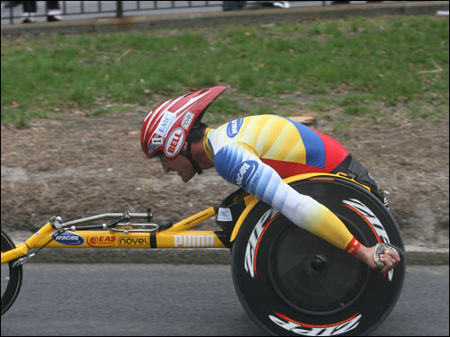 Van Dyk used his long, powerful strokes to take a commanding lead in the men's wheelchair race.