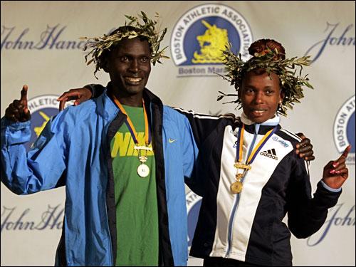 Boston Marathon men's winner Robert Cheruiyot of Kenya, and women's winner Rita Jeptoo of Kenya posed for photos during a news conference.