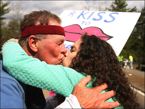The kisses kept coming on the Wellesley stretch of the route. Per her sign that read, 'A kiss to keep ya going,' Wellesley senior Hillary Hurst gave a kiss to a passing runner during the marathon.