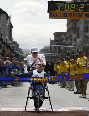 The Hoyts crossed the finish line of their 25th Boston Marathon in a time of 3:08:27.