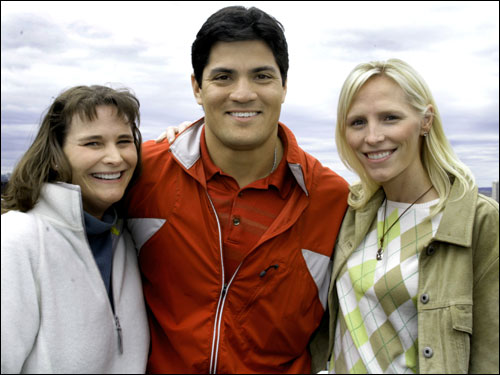Kati Conway with her brother in-law Patriots Tedy Bruschi and his wife Heidi were watching over the race at the Boston Marathon Lenox Hotel rooftop party in Boston.