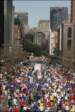 Their journey complete, runners make their way down Boylston Street after finishing.