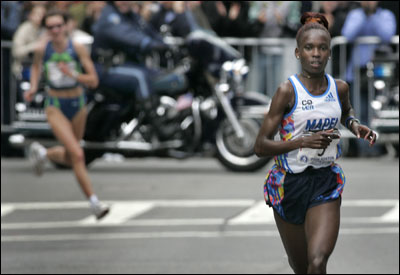 With runner-up Jelena Prokopcuka in the distance down the home stretch, Kenya's Rita Jeptoo coasted to a 10-second win in her Boston debut.