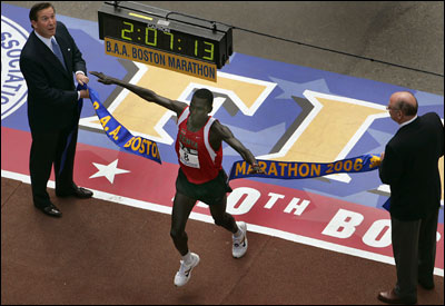 Robert Cheruiyot of Kenya put his familiarity with the course to good use and came from behind to break the finish banner in record Boston time, rounded up to an official 2:07:14.
